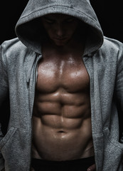 Close up of muscular sports man after weights training