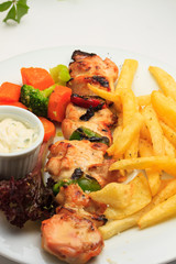Chicken skewers with salad greens