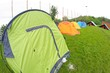 camp with tents scout campers in a green meadow