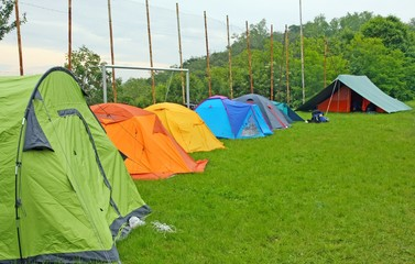 camp with tents scout campers in a meadow
