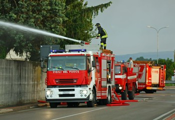 firefighters with the fire truck when switching off a fire