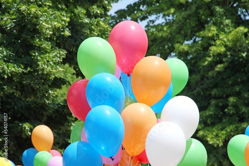 balloons during a party for children and background leaves and g