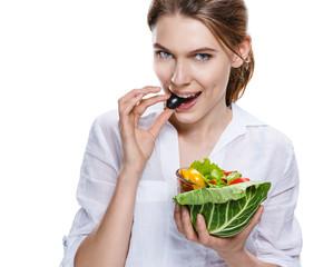 seductive european woman & vegetable salad - isolated on white