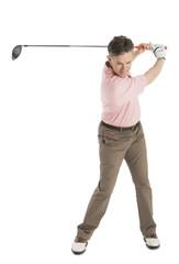 Mature Male Golfer Swinging Golf Club