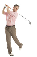 Man Swinging Golf Club Against White Background