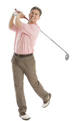 Happy Golfer Looking Away While Swinging Golf Club