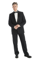 Portrait Of Confident Mature Man Wearing Tuxedo