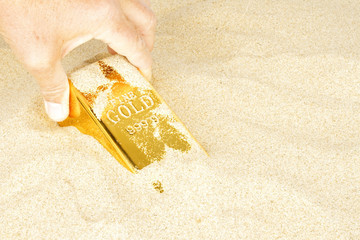 Digging up a goldbar in sand