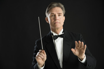 Confident Orchestra Conductor Directing With His Baton