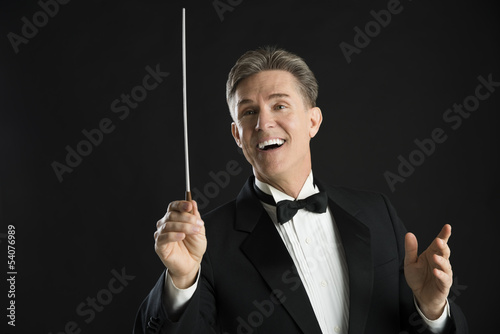 Male Orchestra Conductor Looking Away While Directing