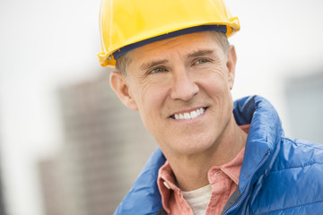 Happy Construction Worker Looking Away