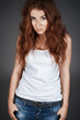 red-haired girl with freckles in the studio. Teen girl with brig