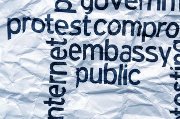 Protest embassy text on  crinkled paper