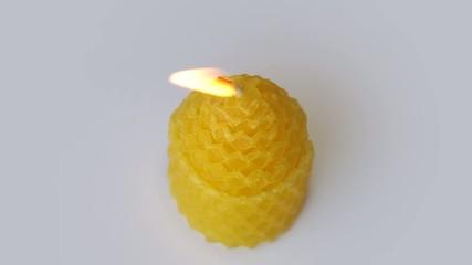 Candle rotates