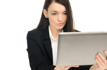 Beautiful business woman using a tablet at work