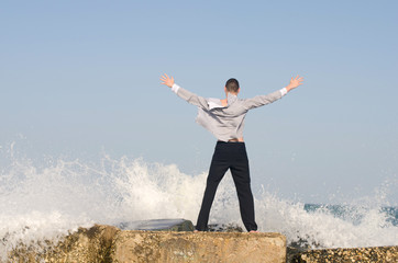 Young beautiful businessman enjoy the waves and relax