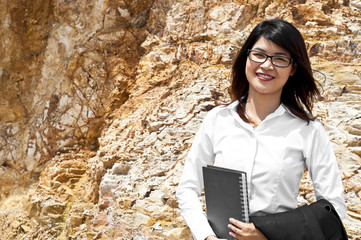 Beautiful Asian geologist woman researching in stratigraphy.