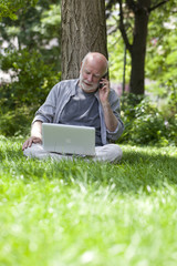 media connected senior man outdoors