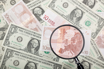 Focusing on Euro banknote against US and Euro currencies