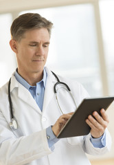Doctor Using Digital Tablet In Clinic
