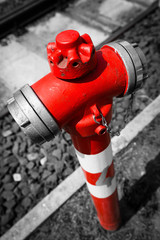 Typical red fire hydrant details along the tram rails