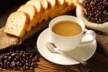 Coffee cup with sliced bread  and fresh coffee beans