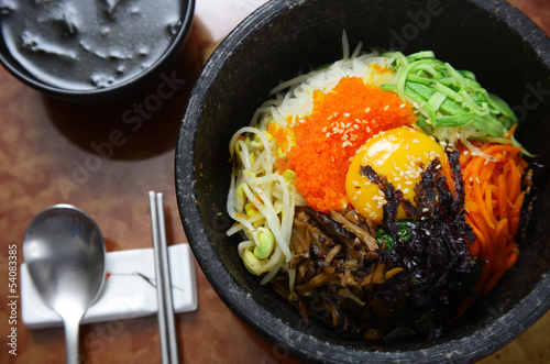Poster Korean cuisine : bibimbap in a heated stone bowl