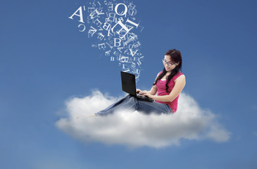 Asian female send email message on cloud