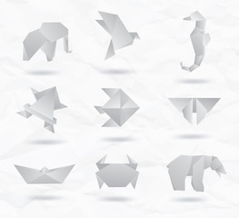 Set of white origami animals symbols from paper