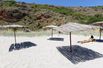 Suntanned girl umbrela beach