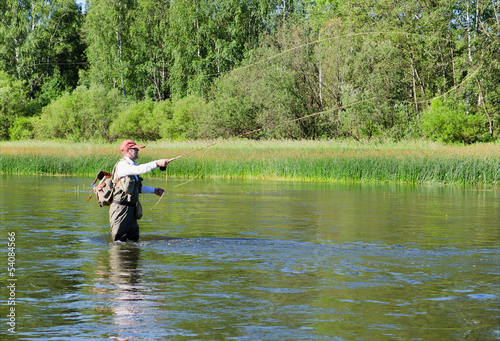 Fisherman catches of chub  fly fishing in the Chusovaya river