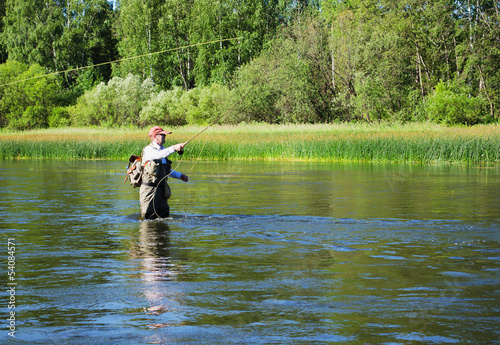 Staande foto Vissen Fisherman catches of chub fly fishing in the Chusovaya river