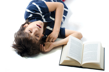 Young student sleeping with open book next to him