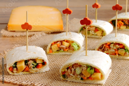 Sliced tortilla wrap with cheese and vegetables