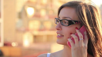 Pretty young woman using mobile phone - Smartphone