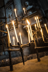candles in a gothic church building