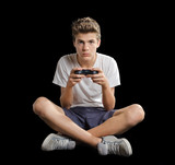 Cute teenager sitting on the floor playing videogames poster