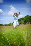 Happy teenager in summer field