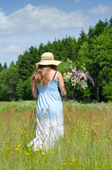 Teenager in summer field