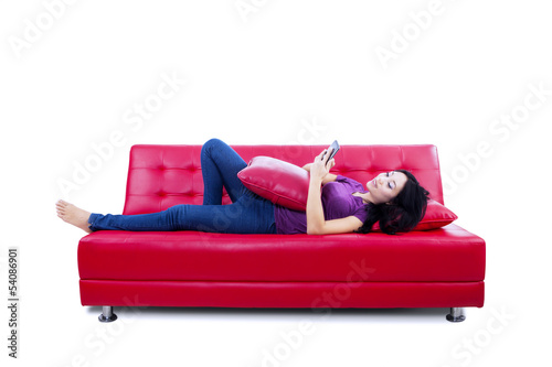 Young woman reading e-book