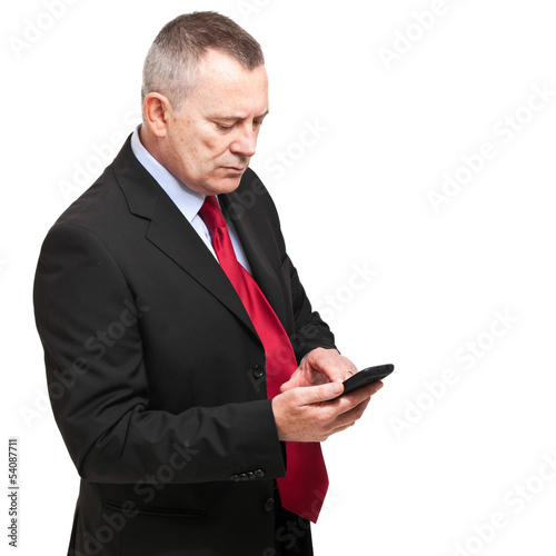 Businessman writing a sms