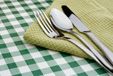 flatware on green Gingham table cloth
