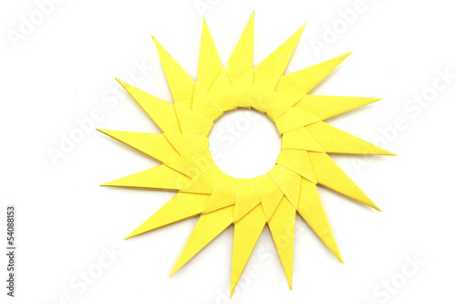 Origami  yellow paper sun on a white