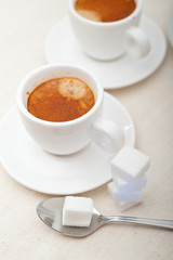 Italian espresso coffee and sugar cubes