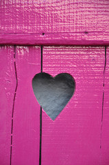 Fuchsine painted wooden window shutter with cut out Heart shape