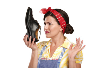 beautiful vintage housekeeper holding  a smelly shoes with facia