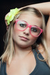 young beauty with pink glasses