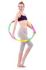 Woman doing exercises with hula hoop