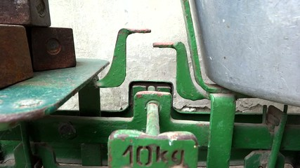 close up old scale in use