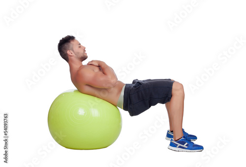 Strong man practicing abdominal on a big ball